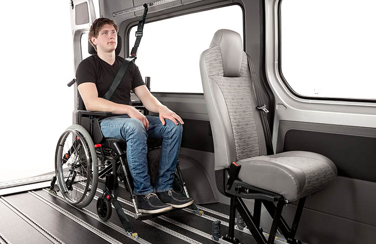 A combined occupant belt and wheelchair tie-down system that mounts in the rails of an Innotrax floor and a Surface rail on the vehicle side.